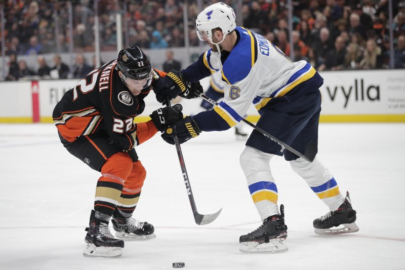 Anaheim Ducks' Adam Cracknell, left, is defended by St. Louis Blues' Joel Edmundson during the second period of an NHL hockey game, Wednesday, Jan. (AP Photo/Jae C. Hong)