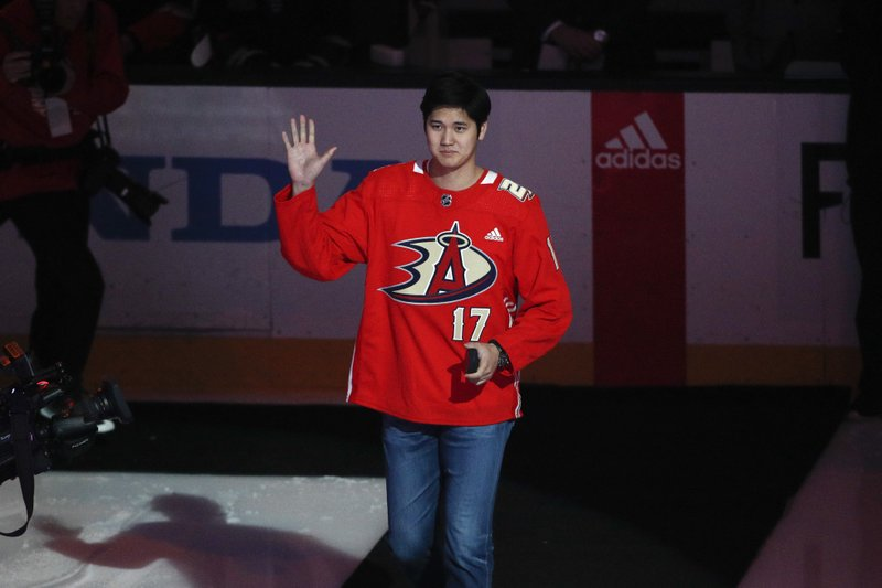 Los Angeles Angels pitcher Shohei Ohtani, of Japan, arrives for the ceremonial puck drop before an NHL hockey game between the Anaheim Ducks and the St. (AP Photo/Jae C. Hong)