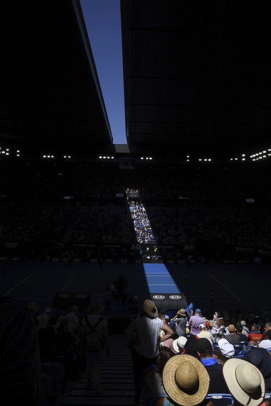 The roof of Rod Laver Arena is closed during the women's semifinal between Petra Kvitova of the Czech Republic and United States' Danielle Collins due to extreme heat at the Australian Open tennis championships in Melbourne, Australia, Thursday, Jan. (AP Photo/Andy Brownbill)