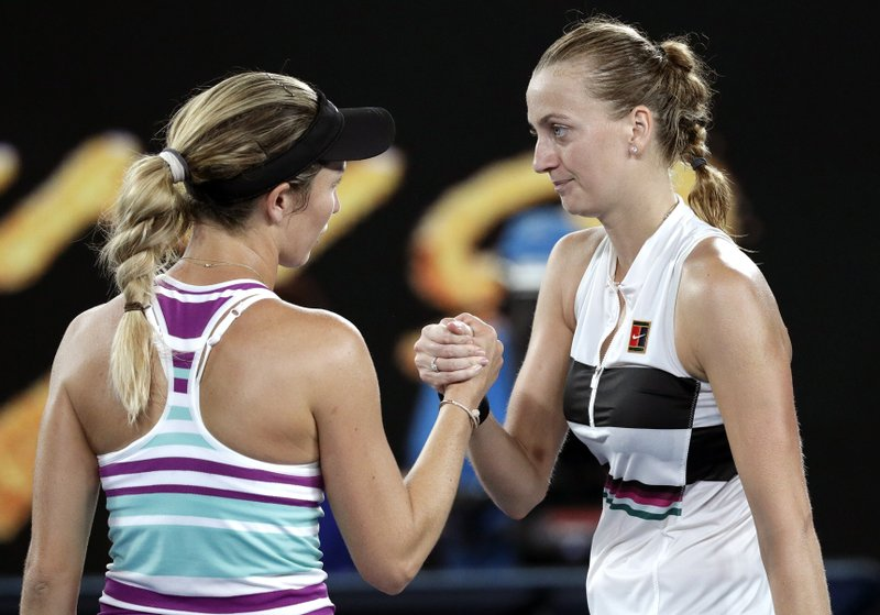Petra Kvitova, right, of the Czech Republic is congratulated by United States' Danielle Collins after winning their semifinal at the Australian Open tennis championships in Melbourne, Australia, Thursday, Jan. (AP Photo/Kin Cheung)