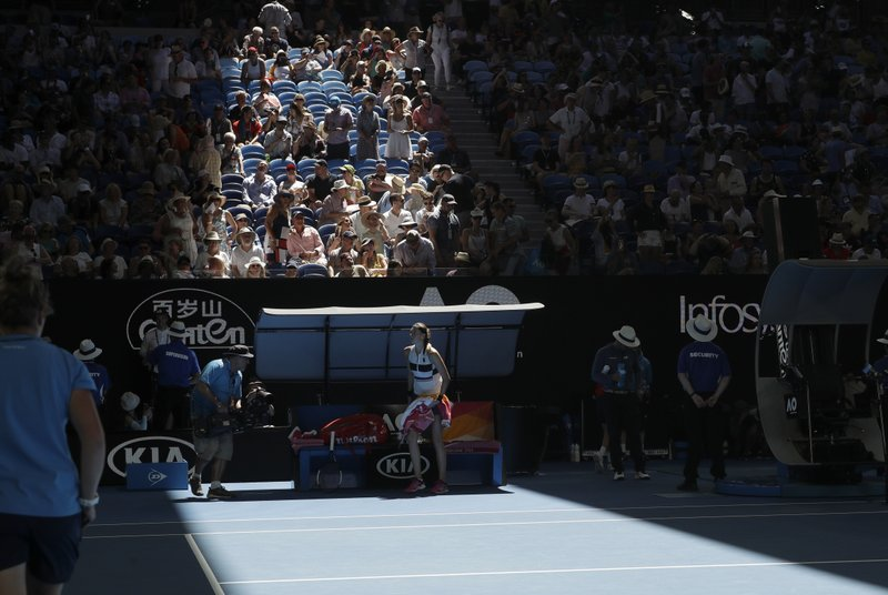 Petra Kvitova of the Czech Republic waits as the roof of Rod Laver Arena is closed due to extreme heart during her semifinal against United States' Danielle Collins at the Australian Open tennis championships in Melbourne, Australia, Thursday, Jan. (AP Photo/Kin Cheung)