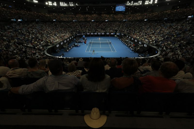 Spectators watch the women's semifinal between Japan's Naomi Osaka and Karolina Pliskova of the Czech Republic on Rod Laver Arena after the roof was closed due to extreme heat at the Australian Open tennis championships in Melbourne, Australia, Thursday, Jan. (AP Photo/Aaron Favila)