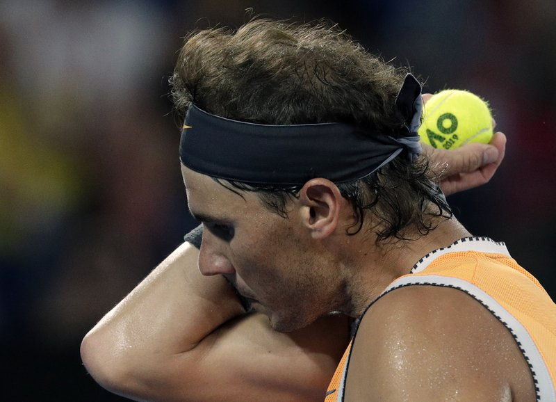 Spain's Rafael Nadal wipes the sweat from his face during his semifinal against Greece's Stefanos Tsitsipas at the Australian Open tennis championships in Melbourne, Australia, Thursday, Jan. (AP Photo/Aaron Favila)
