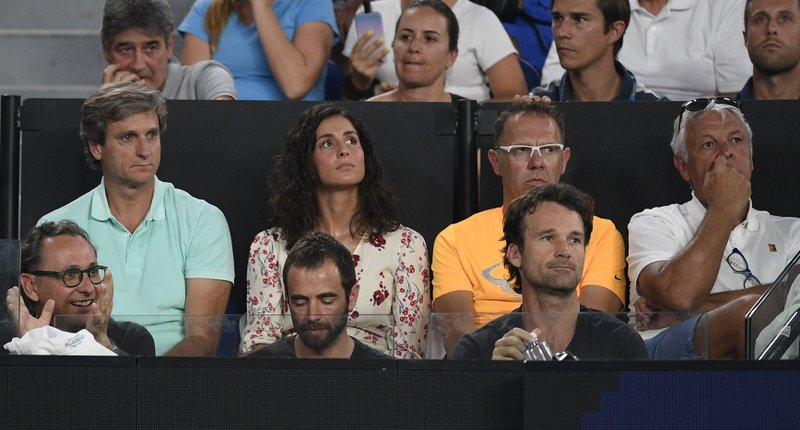 Supporters of Spain's Rafael Nadal watch from the players box his semifinal match against Greece's Stefanos Tsitsipas at the Australian Open tennis championships in Melbourne, Australia, Thursday, Jan. (AP Photo/Andy Brownbill)