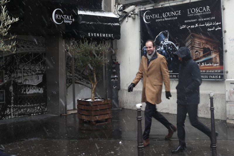 People walk past the Crystal Club in Paris, Tuesday Jan.22, 2019. U.S. singer Chris Brown and two other people are in custody in Paris after a woman filed a rape complaint, French officials said Tuesday. (AP Photo/Thibault Camus)