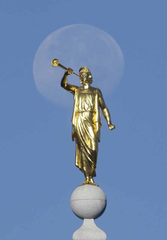FILE - In this Sept. 11, 2014, file photo, the angel Moroni statue sits atop the Salt Lake Temple at Temple Square in Salt Lake City. (AP Photo/Rick Bowmer, File)