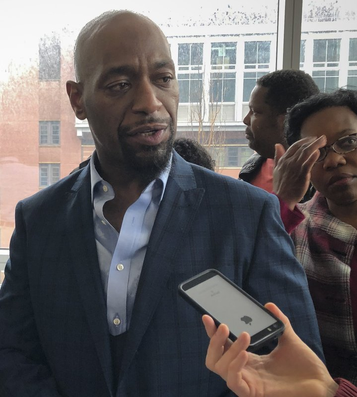 Huwe Burton speaks with reporters at the Bronx County Hall of Justice on Thursday, Jan. 24, 2019, in New York, after his conviction was dismissed in the 1989 killing of his mother. (AP Photo/Jennifer Peltz)