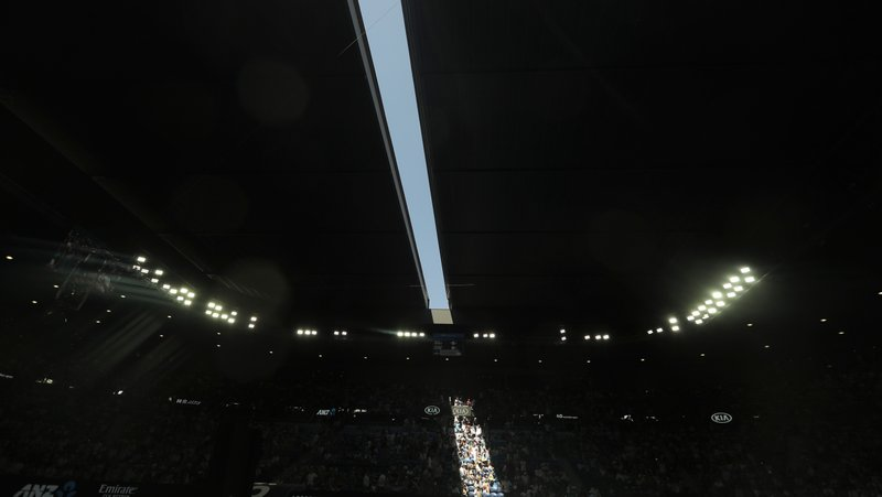 The roof to Rod Laver Arena is closed during the women's semifinal between Petra Kvitova of the Czech Republic and United States' Danielle Collins due to extreme heat at the Australian Open tennis championships in Melbourne, Australia, Thursday, Jan. (AP Photo/Mark Schiefelbein)