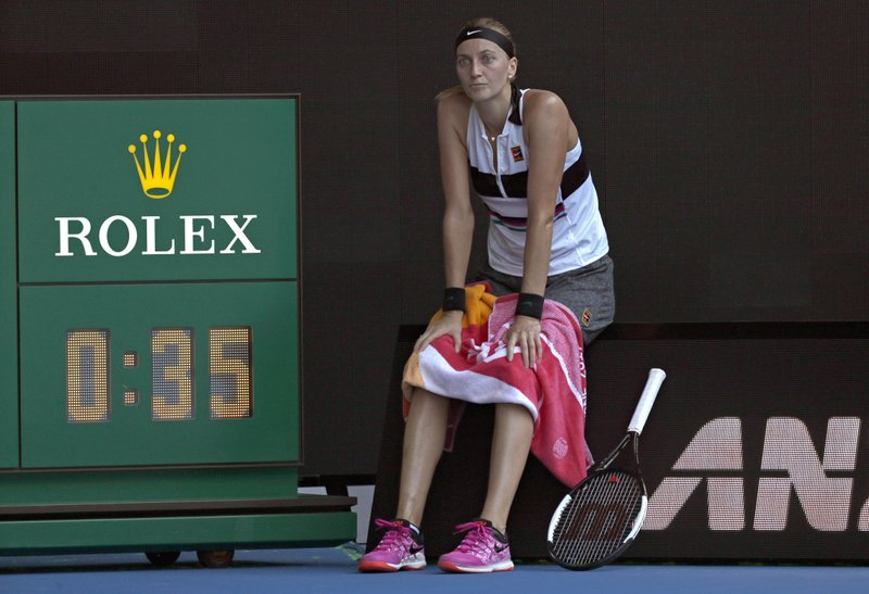 Petra Kvitova of the Czech Republic waits as the roof of Rod Laver Arena is closed due to extreme heat during her semifinal against United States' Danielle Collins at the Australian Open tennis championships in Melbourne, Australia, Thursday, Jan. (AP Photo/Kin Cheung)