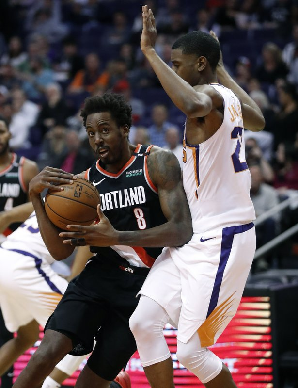 Portland Trail Blazers forward Al-Farouq Aminu (8) drives around Phoenix Suns forward Josh Jackson during the second half of an NBA basketball game Thursday, Jan. (AP Photo/Matt York)