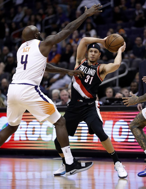 Portland Trail Blazers guard Seth Curry (31) looks to pass the ball as Phoenix Suns forward Quincy Acy (4) defends during the second half of an NBA basketball game Thursday, Jan. (AP Photo/Matt York)