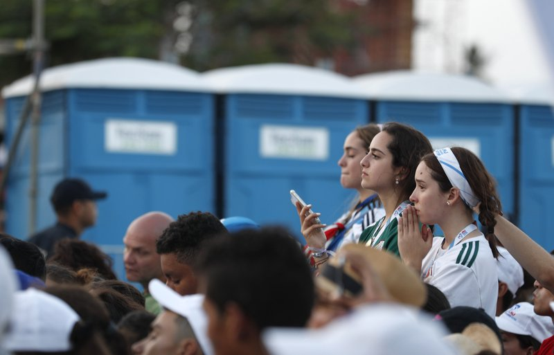 Pilgrims get a view of Pope Francis during a welcoming ceremony to open his participation in the church's World Youth Day festivities in Panama City, Thursday, Jan. (AP Photo/Rebecca Blackwell)