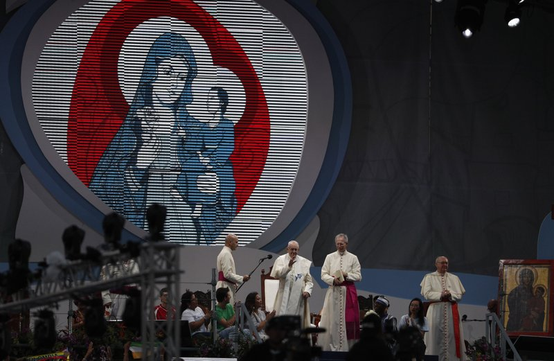 Pope Francis waves to the crowd during a welcoming ceremony to open his participation in the church's World Youth Day festivities in Panama City, Thursday, Jan. (AP Photo/Rebecca Blackwell)