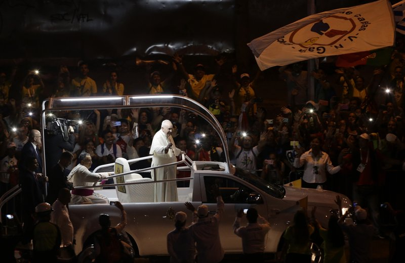 Pope Francis waves to the crowd as he rides his popemobile in Panama City, Thursday, Jan. 24, 2019. Pope Francis has arrived in Panama amid a political crisis in nearby Venezuela, a migration standoff over the proposed U. (AP Photo/Arnulfo Franco)