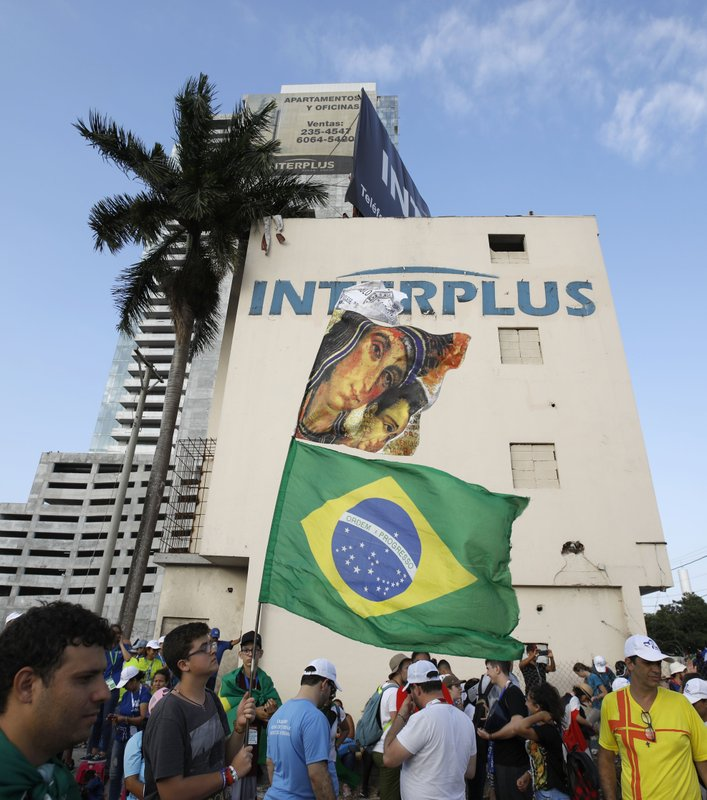 Brazilian pilgrims hold a Brazil flag as Pope Francis arrives for a welcoming ceremony to open his participation in the church's World Youth Day festivities in Panama City, Thursday, Jan. (AP Photo/Rebecca Blackwell)