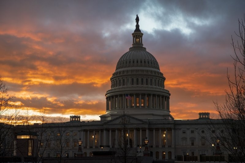 The Capitol iat sunset after the Senate rejected competing Democratic and Republican proposals for ending the partial government shutdown, which is the longest in the nation's history, in Washington, Thursday, Jan. (AP Photo/J. Scott Applewhite)