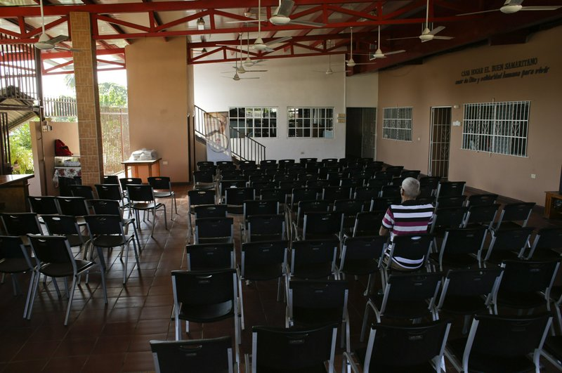 A man sits inside the the Good Samaritan home, a Roman Catholic-run shelter for HIV and AIDS patients in Panama City, Saturday, Jan. (AP Photo/Arnulfo Franco)