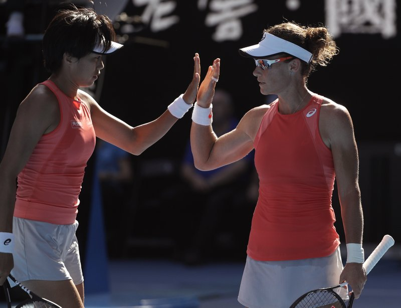 China's Zhang Shuai, left, and Australia's Samantha Stosur celebrate a point win over France's Kristina Mladenovic and Hungary's Timea Babos during the women's doubles final at the Australian Open tennis championships in Melbourne, Australia, Friday, Jan. (AP Photo/Mark Schiefelbein)