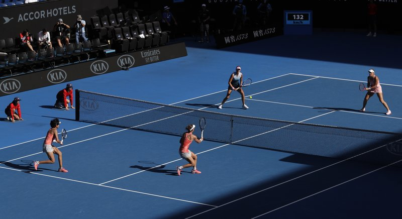China's Zhang Shuai, left, and Australia's Samantha Stosur, second from left, play France's Kristina Mladenovic, second from right, and Hungary's Timea Babos in the women's doubles final at the Australian Open tennis championships in Melbourne, Australia, Friday, Jan. (AP Photo/Kin Cheung)