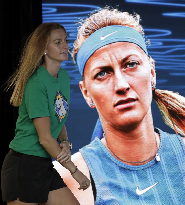 Petra Kvitova of the Czech Republic arrives at a press conference at the Australian Open tennis championships in Melbourne, Australia, Friday, Jan. (AP Photo/Kin Cheung)