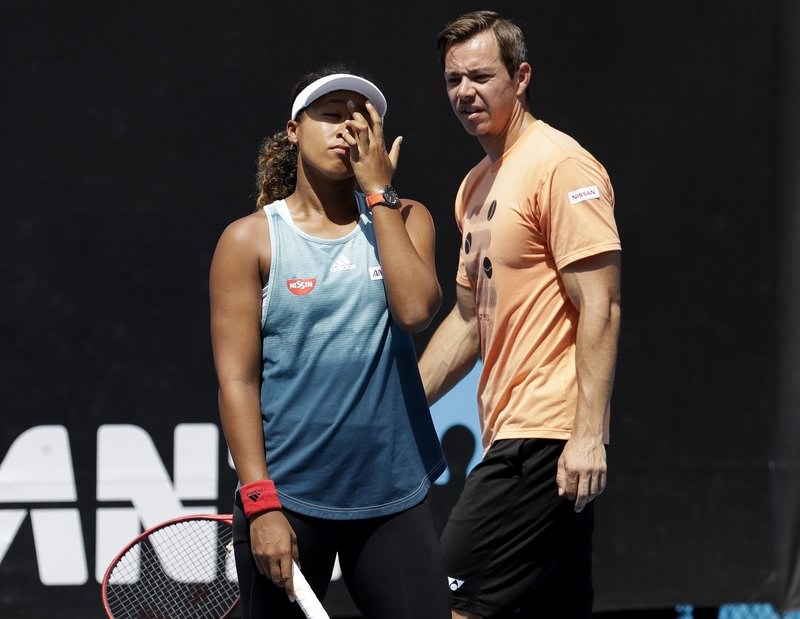 Sascha Bajin, coach Japan's Naomi Osaka talks with her during a practice session at the Australian Open tennis championships in Melbourne, Australia, Friday, Jan. (AP Photo/Mark Baker)
