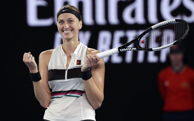 Petra Kvitova of the Czech Republic celebrates after defeating United States' Danielle Collins in their semifinal at the Australian Open tennis championships in Melbourne, Australia, Thursday, Jan. (AP Photo/Kin Cheung)