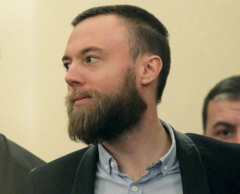 Briton Jack Shepherd stands in a court room in Tbilisi, Georgia, Friday, Jan. 25, 2019. A court in the ex-Soviet republic of Georgia has ruled to keep Shepherd a fugitive British man for three months behind bars pending possible extradition. (AP Photo/Shakh Aivazov)