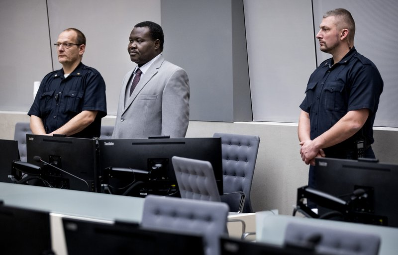 The chief of Central African Republic's soccer federation Patrice-Edouard Ngaissona stands during his initial appearance before the judges of the International Criminal Court (ICC) in The Hague, the Netherlands, Friday, Jan. (Koen Van Well/Pool photo via AP)