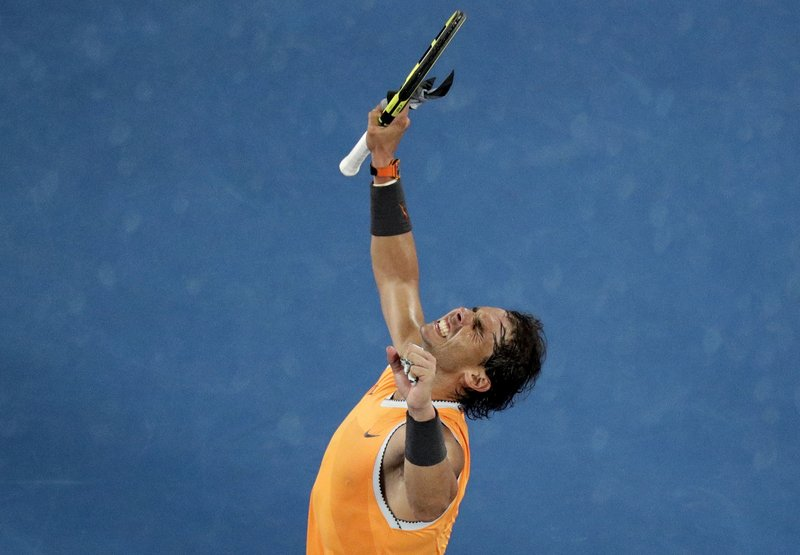 Spain's Rafael Nadal celebrates after defeating Greece's Stefanos Tsitsipas in their semifinal at the Australian Open tennis championships in Melbourne, Australia, Thursday, Jan. (AP Photo/Kin Cheung)