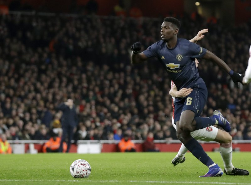Manchester United's Paul Pogba, left, duels for the ball with Arsenal's Granit Xhaka during the English FA Cup fourth round soccer match between Arsenal and Manchester United at the Emirates stadium in London, Friday, Jan. (AP Photo/Matt Dunham)