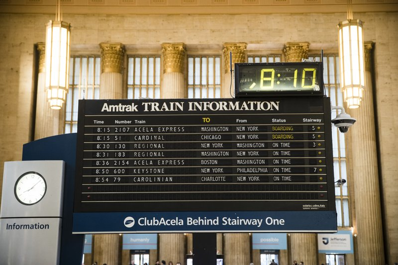 FILE - In this Dec. 12, 2018, file photo, the Amtrak train departures board is shown at the 30th Street Station in Philadelphia. (AP Photo/Matt Rourke, File)