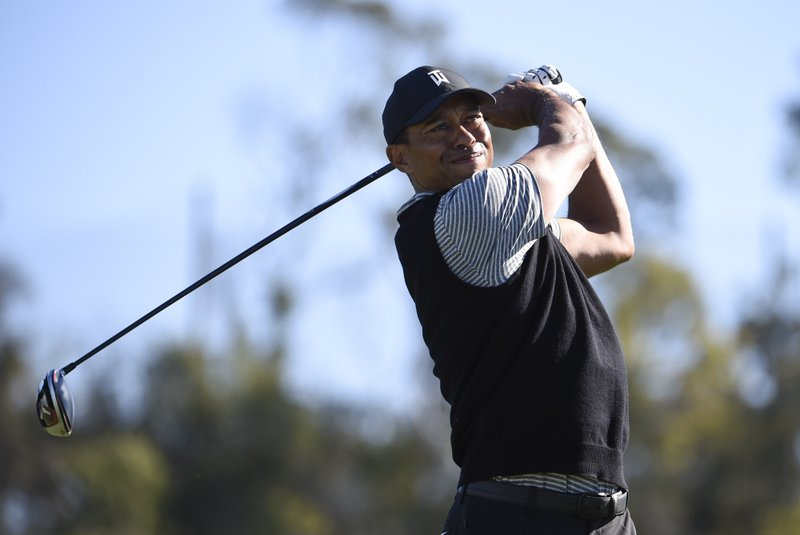 Tiger Woods hits his tee shot on the 14th hole during the second round of the Farmers Insurance Open golf tournament on the North Course at the Torrey Pines on Friday, Jan. (AP Photo/Denis Poroy)