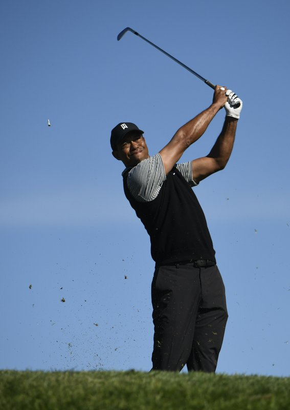 Tiger Woods hits his tee shot on the 15th hole during the second round of the Farmers Insurance Open golf tournament on the North Course at the Torrey Pines on Friday, Jan. (AP Photo/Denis Poroy)