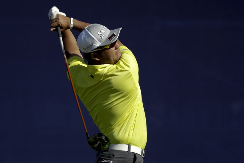Hideki Matsuyama, of Japan, watches his tee shot on the seventh hole during the second round of the Farmers Insurance Open golf tournament on the South Course at Torrey Pines Golf Course on Friday, Jan. (AP Photo/Chris Carlson)