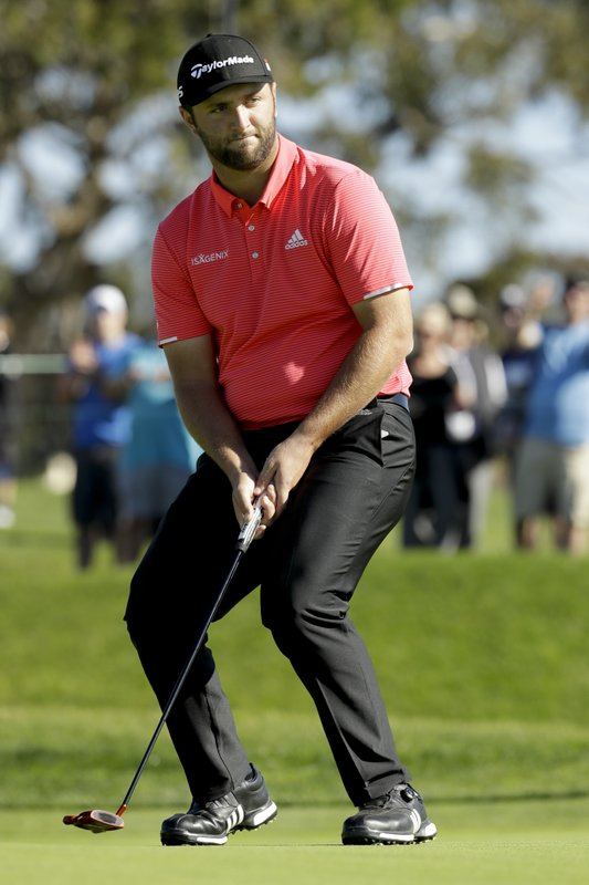 Jon Rahm, of Spain, reacts after missing a birdie on the second hole during the second round of the Farmers Insurance Open golf tournament on the South Course at Torrey Pines on Friday, Jan. (AP Photo/Chris Carlson)