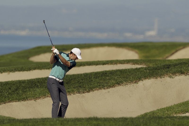 Jordan Spieth hits out of the bunker on the fourth hole during the second round of the Farmers Insurance Open golf tournament on the South Course at Torrey Pines Golf Course on Friday, Jan. (AP Photo/Chris Carlson)