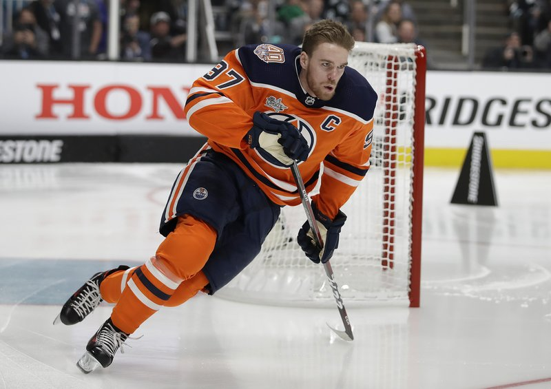 Edmonton Oilers' Connor McDavid skates during the skills competition, part of the NHL hockey All Star weekend, in San Jose, Calif. (AP Photo/Ben Margot)