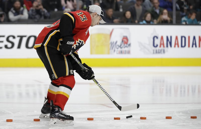 Calgary Flames' Johnny Gaudreau competes in puck control, which he won, during the skills competition at the NHL hockey All-Star weekend in San Jose, Calif. (AP Photo/Ben Margot)