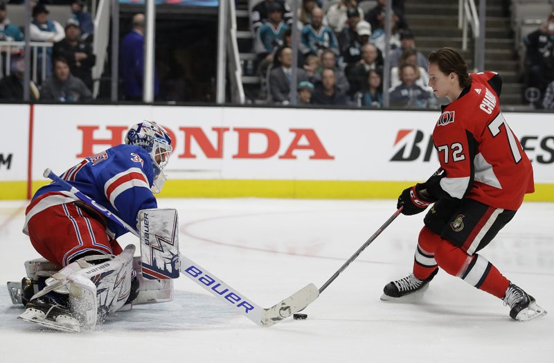 New York Rangers' Henrik Lundqvist, left, defends a shot attempt by Ottawa Senators' Thomas Chabot during the Skills Competition, part of the NHL hockey All-Star weekend, in San Jose, Calif. (AP Photo/Ben Margot)