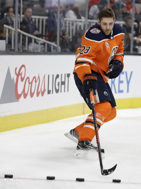 Edmonton Oilers' Leon Draisaitl competes during the premier passer contest, which he won, in the skills competition, part of the NHL hockey All-Star weekend, in San Jose, Calif. (AP Photo/Ben Margot)