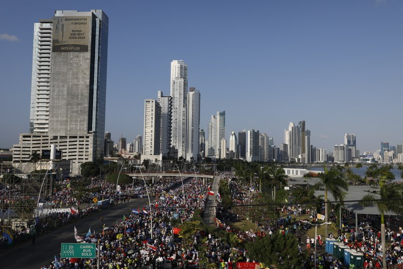 Thousands gather to get a glimpse of Pope Francis, along the Cinta Costera in Panama City, at sunset Friday, Jan. (AP Photo/Rebecca Blackwell)