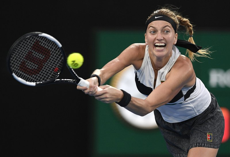 Petra Kvitova of the Czech Republic hits a backhand to Japan's Naomi Osaka during the women's singles final at the Australian Open tennis championships in Melbourne, Australia, Saturday, Jan. (AP Photo/Andy Brownbill)