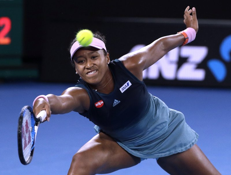 Japan's Naomi Osaka makes a forehand return to Petra Kvitova of the Czech Republic during the women's singles final at the Australian Open tennis championships in Melbourne, Australia, Saturday, Jan. (AP Photo/Mark Schiefelbein)