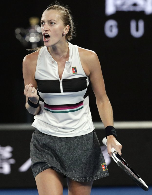 Petra Kvitova of the Czech Republic reacts after winning a point against Japan's Naomi Osaka during the women's singles final at the Australian Open tennis championships in Melbourne, Australia, Saturday, Jan. (AP Photo/Aaron Favila)