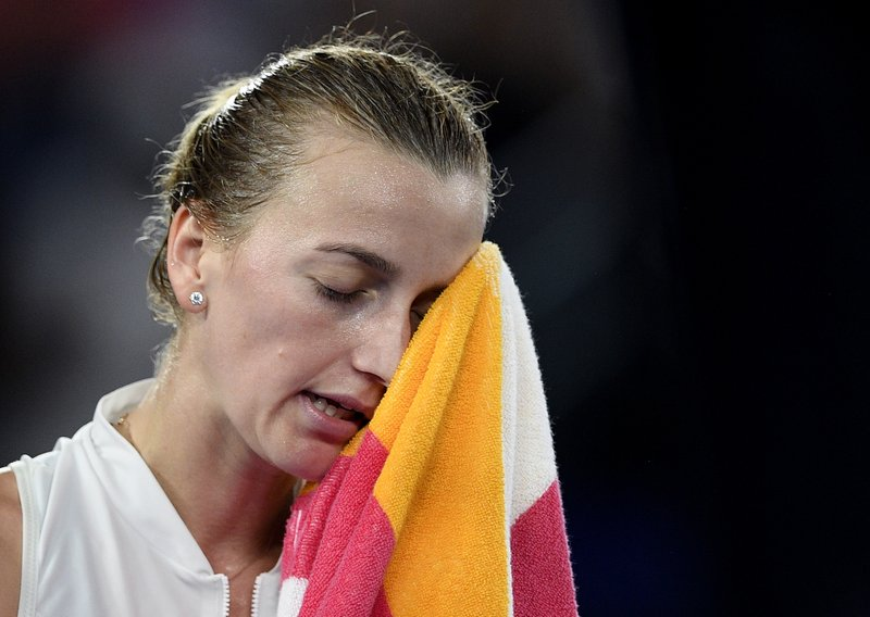 Petra Kvitova of the Czech Republic wipes sweat from her face during her women's singles final against Japan's Naomi Osaka at the Australian Open tennis championships in Melbourne, Australia, Saturday, Jan. (AP Photo/Andy Brownbill)