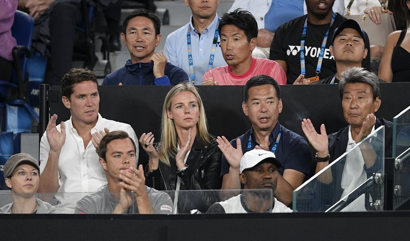 Supporters of Japan's Naomi Osaka cheer her on during her match against Petra Kvitova of the Czech Republic in the women's singles final at the Australian Open tennis championships in Melbourne, Australia, Saturday, Jan. (AP Photo/Andy Brownbill)