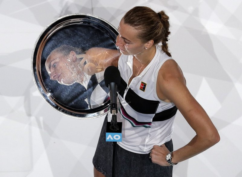 Petra Kvitova of the Czech Republic holds her trophy as she speaks after losing to Japan's Naomi Osaka in the women's singles final at the Australian Open tennis championships in Melbourne, Australia, Saturday, Jan. (AP Photo/Kin Cheung)
