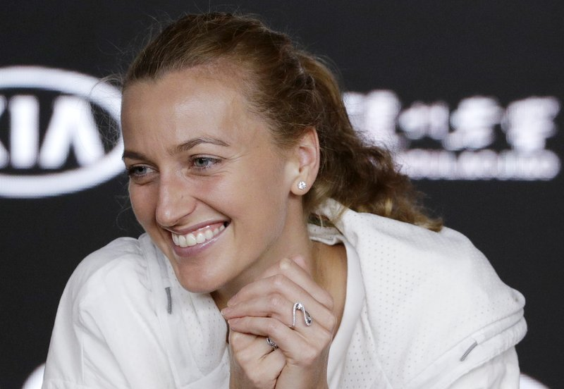 Petra Kvitova of the Czech Republic smiles during a press conference following her loss to Japan's Naomi Osaka in the women's singles final at the Australian Open tennis championships in Melbourne, Australia, Saturday, Jan. (AP Photo/Mark Schiefelbein)