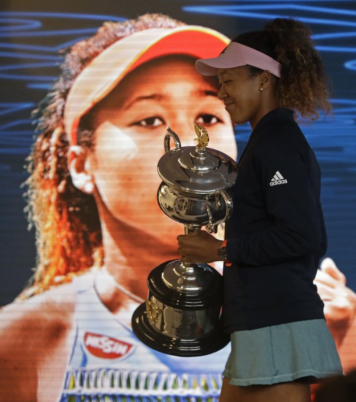 Japan's Naomi Osaka answers questions at a press conference after defeating Petra Kvitova of the Czech Republic in the women's singles final at the Australian Open tennis championships in Melbourne, Australia, early Sunday, Jan. (AP Photo/Mark Schiefelbein)