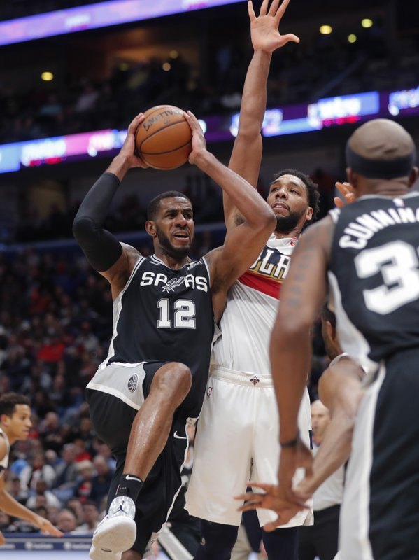 San Antonio Spurs center LaMarcus Aldridge (12) drives to the basket against New Orleans Pelicans center Jahlil Okafor in the second half of an NBA basketball game in New Orleans, Saturday, Jan. (AP Photo/Gerald Herbert)